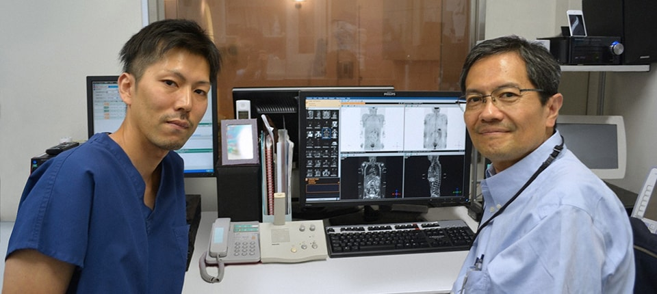 Takanori Naka, MR technologist (left) and Hiroshi Nobusawa, radiologist (right)